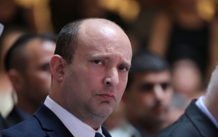 Israeli Prime Minister Naftali Bennett attends a memorial ceremony for soldiers who fell in the 2014 war with Gaza, at the Hall of Remembrance of Mount Herzl military cemetery in Jerusalem June 20, 2021