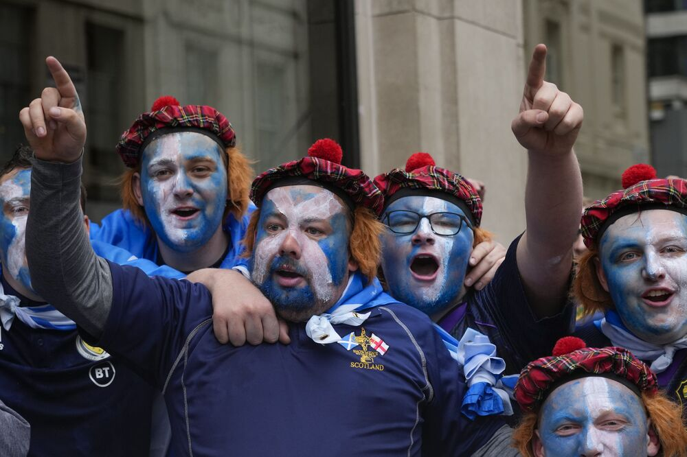 Scotland fans gather in Leicester Square prior to a Group D match between England and Scotland in London. Just take a look at their incredible traditional Scottish bonnets.
