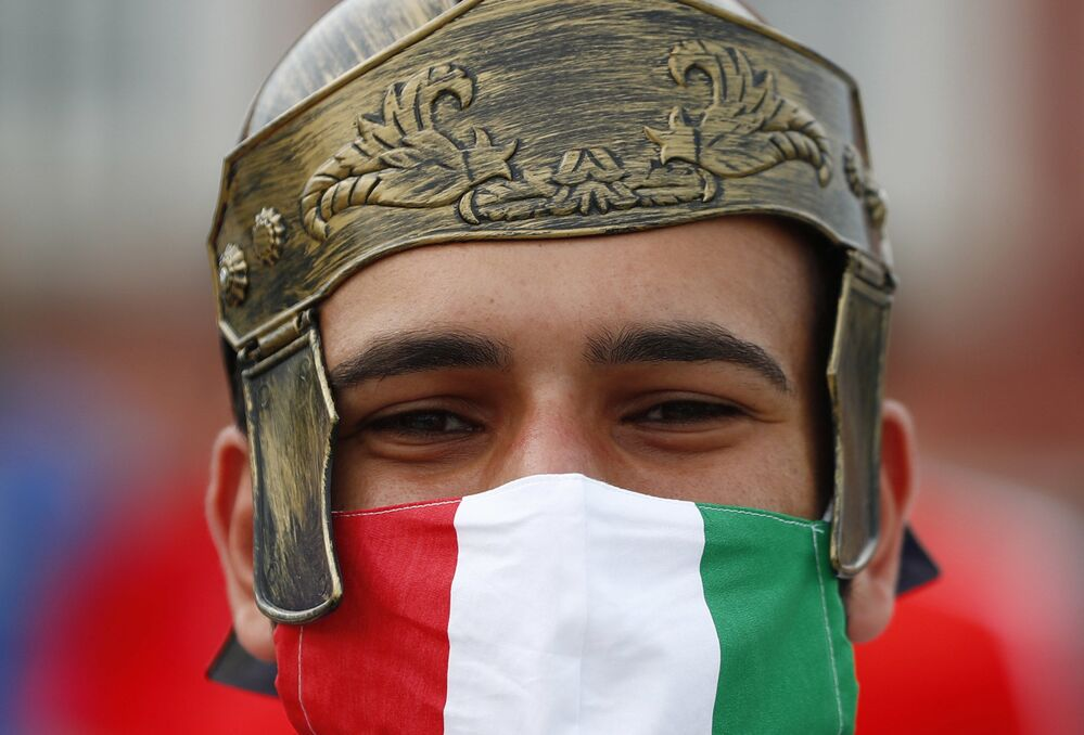 An Italy fan outside a stadium before a match.