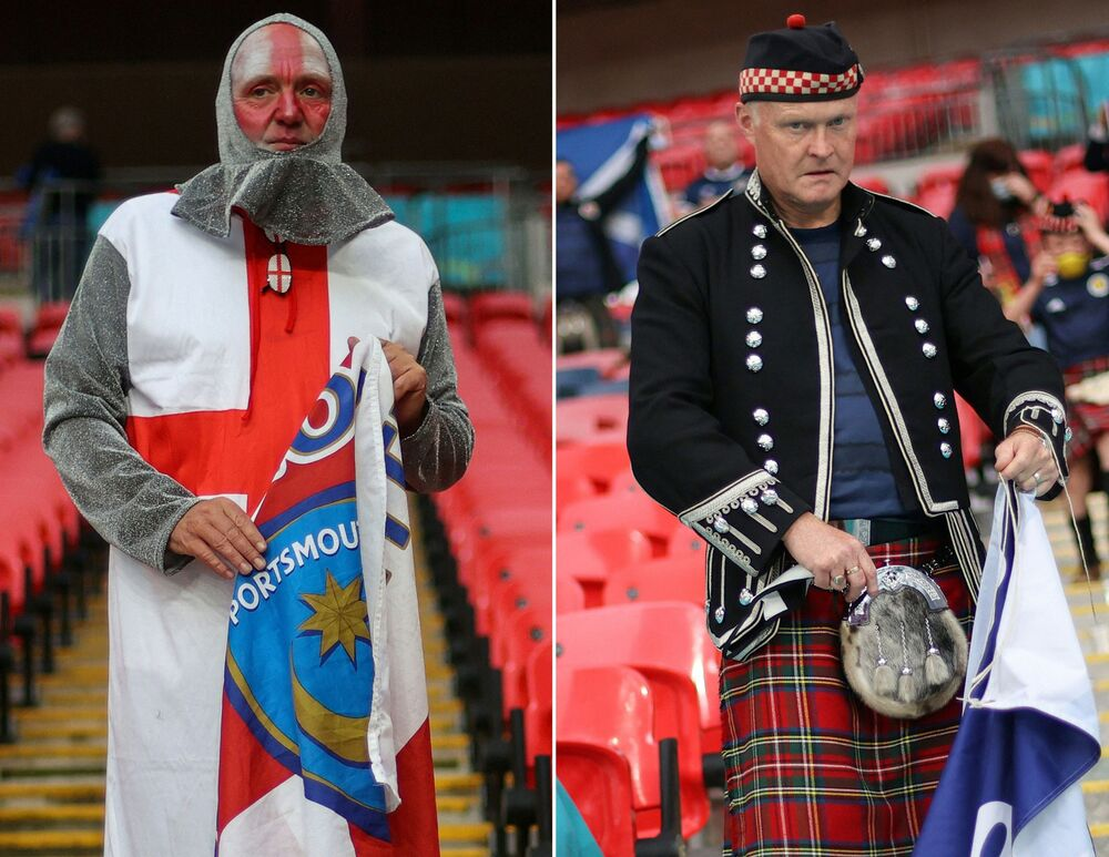 England fan (L) and a Scotland fan arriving prior to a Group D football match between England and Scotland at Wembley Stadium in London.