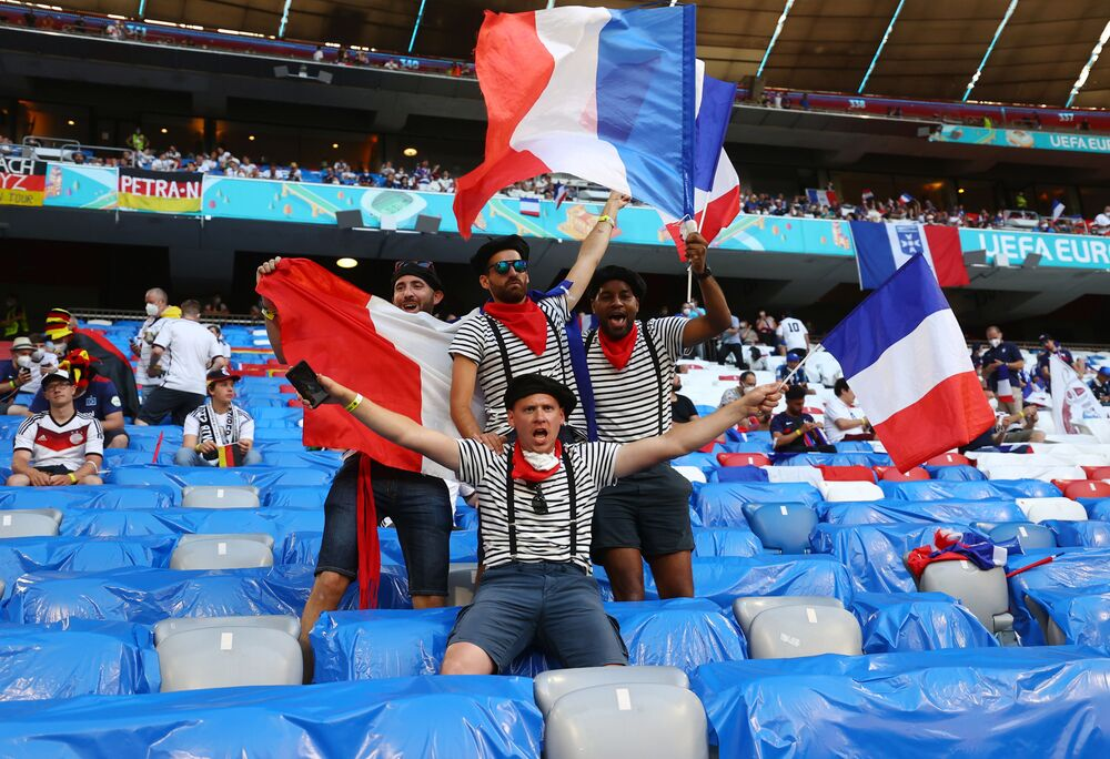 France fans are seen in the stands before a match. One could easily have guessed which team they support even if they didn't have flags. Just take a look at those berets!