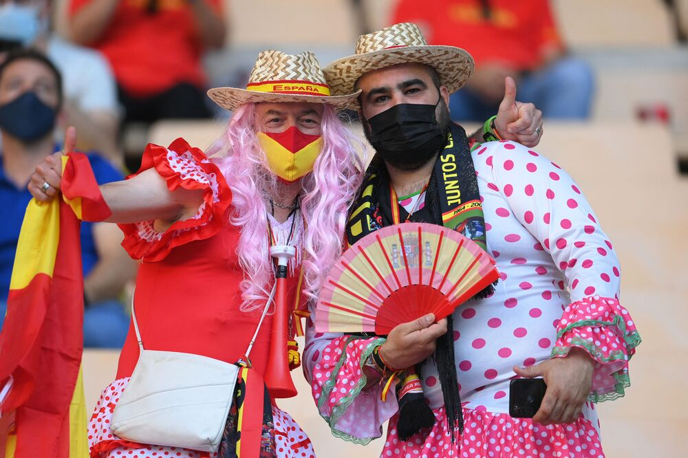 Spain supporters pose for a picture ahead of a match between Spain and Poland at the La Cartuja Stadium in Seville.