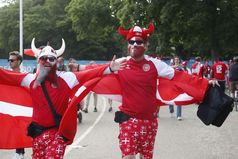 Denmark fans getting ready to support their team before a match against Finland. It's hard to imagine Danish fans without their horned helmets.