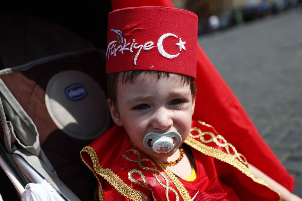 A young Turkey fan in Rome before a match against Italy. The kid is wearing a traditional Turkish fez.