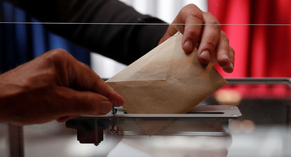 A person casts a vote at a polling station during the first round of French regional and departmental elections, in Le Touquet-Paris-Plage, France June 20, 2021