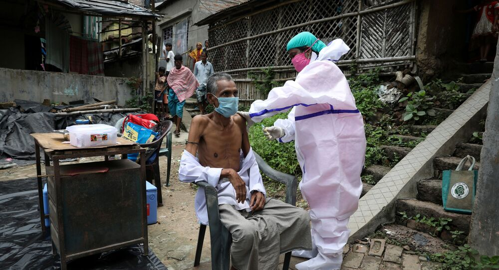 Motiar Rahman, a villager, receives a dose of COVISHIELD vaccine, a coronavirus disease (COVID-19) vaccine manufactured by Serum Institute of India, during a door-to-door vaccination and testing drive at Uttar Batora Island in Howrah district in West Bengal state, India, June 21, 2021.