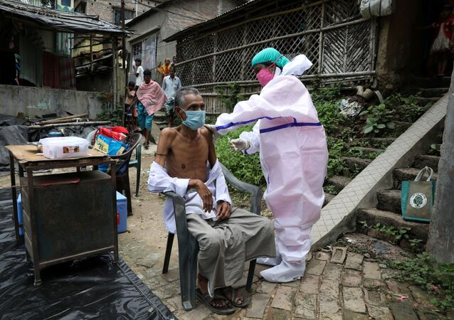 Motiar Rahman, a villager, receives a dose of COVISHIELD vaccine, a coronavirus disease (COVID-19) vaccine manufactured by the Serum Institute of India, during a door-to-door vaccination and testing drive at Uttar Batora Island in Howrah district in West Bengal state, India, 21 June 2021.