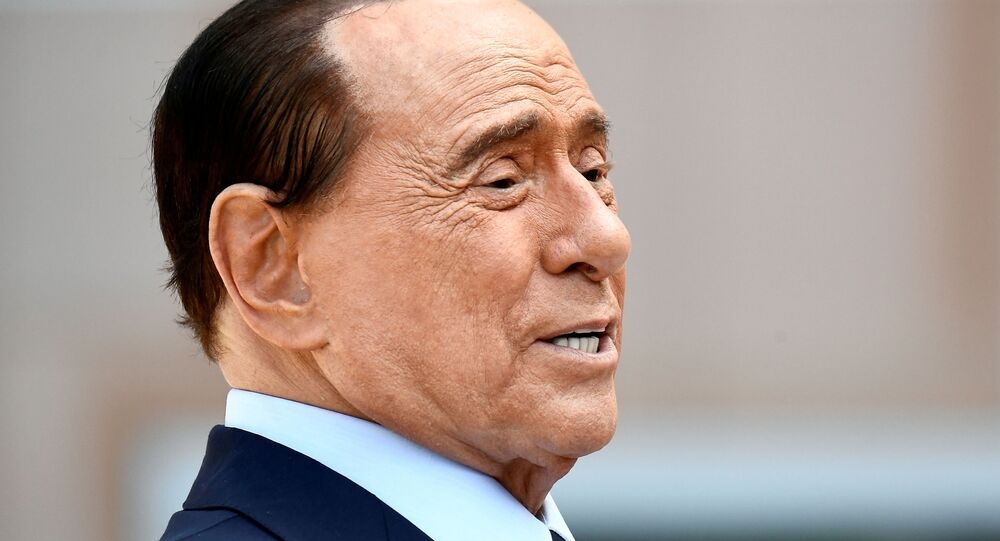 Former Italian Prime Minister Silvio Berlusconi speaks to the media as he leaves San Raffaele hospital in Milan, Italy, September 14, 2020.