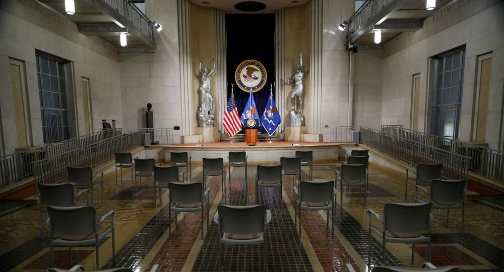 Empty chairs are arranged for social distancing, ahead of U.S. Attorney General Merrick Garland's remarks on voting rights, inside the Great Hall at the U.S. Department of Justice in Washington, U.S., June 11, 2021.