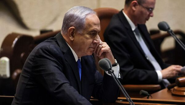 Israeli Prime Minister Benjamin Netanyahu looks on as he delivers a speech during a special session of the Knesset, Israel's parliament, whereby a confidence vote will be held to approve and swear-in a new coalition government, in Jerusalem June 13, 2021 - Sputnik International
