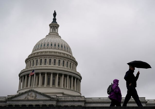 People walk past the Capitol Dome ahead of an expected vote in the impeachment trial of U.S. President Donald Trump on Capitol Hill in Washington, U.S., February 5, 2020.