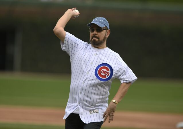 Actor James Michael Tyler throws out the ceremonial first pitch before a baseball game between the Chicago Cubs and St. Louis Cardinals Saturday, Sept. 21, 2019, in Chicago