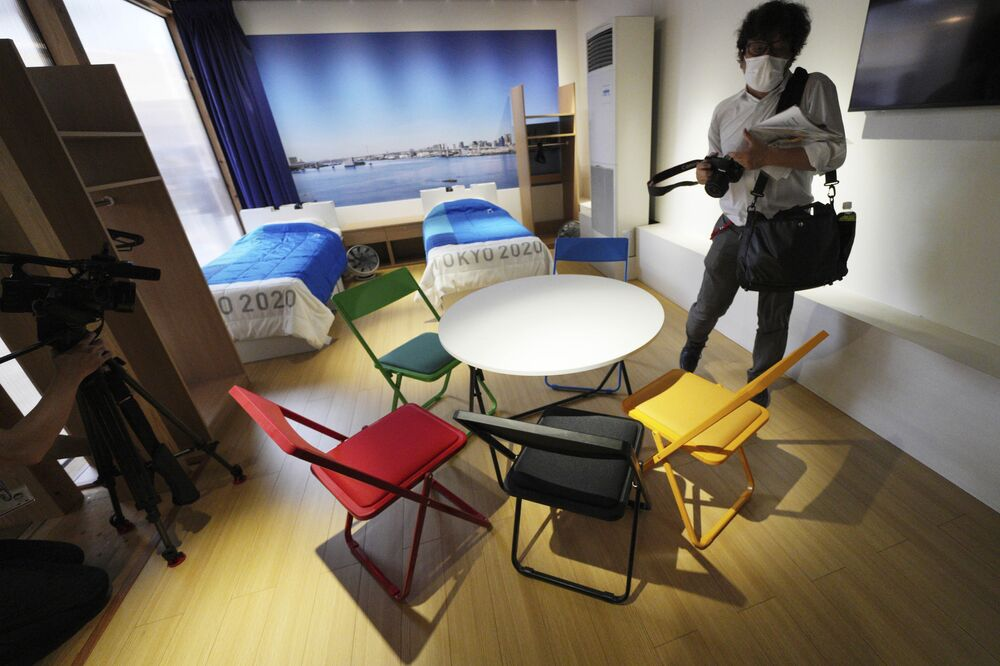 Bedroom furniture, including cardboard beds, for the Tokyo 2020 Olympic and Paralympic Village is shown in a display room at the Village Plaza.