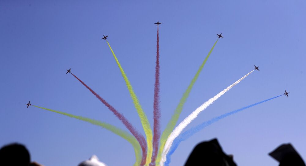 In this Wednesday, Nov. 7, 2018, file photo, China's K-8 aircrafts from the Aerobatic Team Hongying, meaning Red Eagle, of Chinese PLA's (People's Liberation Army) Air Force perform during the 12th China International Aviation and Aerospace Exhibition, also known as Airshow China 2018, in Zhuhai city, south China's Guangdong province.