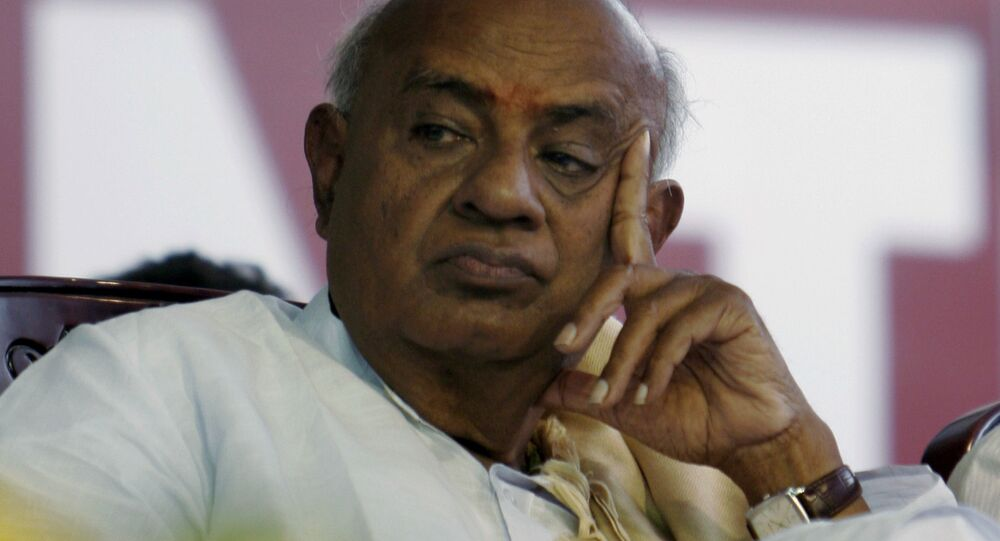 Former Indian prime minister H.D. Deve Gowda looks on during a public meeting in Dobbespet, about 40 kilometers (25 miles) north of Bangalore, India, Thursday March 12, 2009