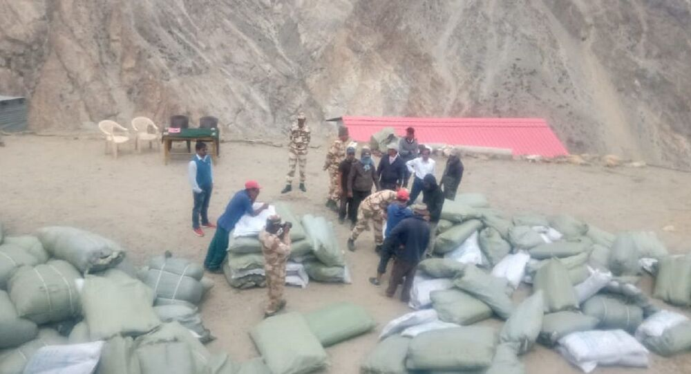 Authorities on Indian side of border check stocks before these are loaded on mules for transportation.