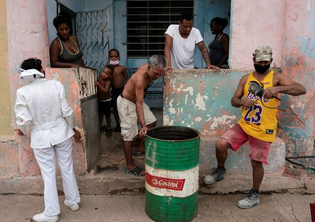 A nurse asks a family to go to a vaccination center amid concerns about the spread of the coronavirus disease (COVID-19), in Havana, Cuba, June 17, 2021.