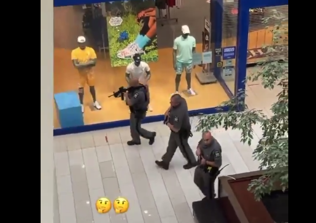 Police scan the inside of the Galleria Mall in New York, following reports of an active shooter. (6/22/2021)
