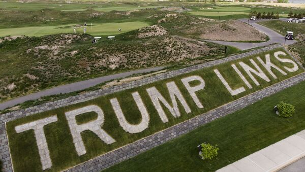 FILE - Patrons play the links as a giant branding sign is displayed with flagstones at Trump Golf Links at Ferry Point in the Bronx borough of New York on Tuesday, May 4, 2021. The Trump Organization sued New York City on Monday, June 21, 2021 for cancelling its contract to run a golf course in the Bronx earlier this year, a move it called ''politically motivated with no basis in the law that should be reversed. - Sputnik International