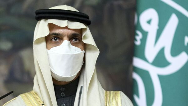 Saudi Foreign Minister Prince Faisal bin Farhan Al-Saud wearing in a face mask to protect himself against coronavirus attend a joint news conference with Russian Foreign Minister Sergey Lavrov following their talks in Moscow, Russia, Thursday, Jan. 14, 2021. - Sputnik International