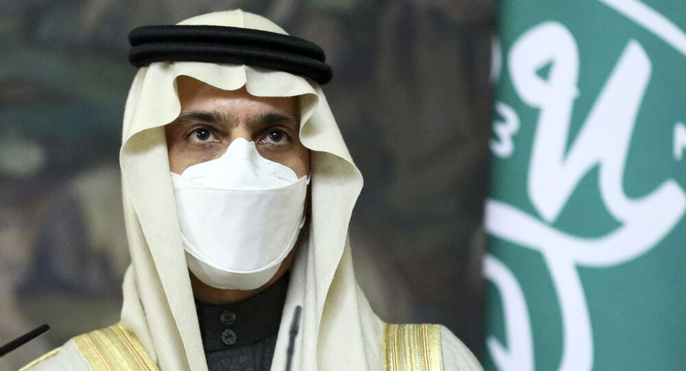 Saudi Foreign Minister Prince Faisal bin Farhan Al-Saud wearing in a face mask to protect himself against coronavirus attend a joint news conference with Russian Foreign Minister Sergey Lavrov following their talks in Moscow, Russia, Thursday, Jan. 14, 2021.