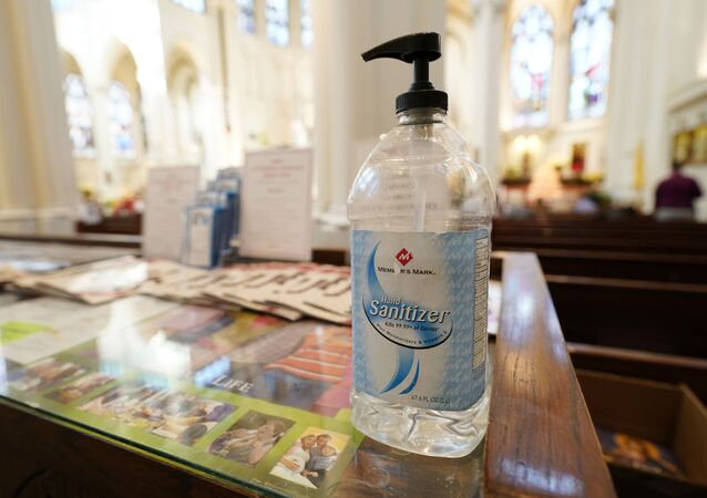A bottle of hand sanitizer stands near an entrance to Cathedral Basilica of the Immaculate Conception, where Christmas services were being held Thursday, Dec. 24, 2020, in Denver.