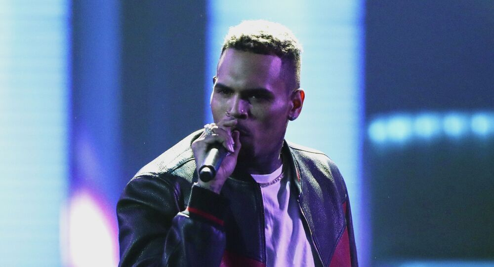 In this June 25, 2017, file photo, Chris Brown performs at the BET Awards at the Microsoft Theater in Los Angeles. Brown says he's having a high-end yard sale at his Los Angeles home, and a crowd has been gathering for hours.
