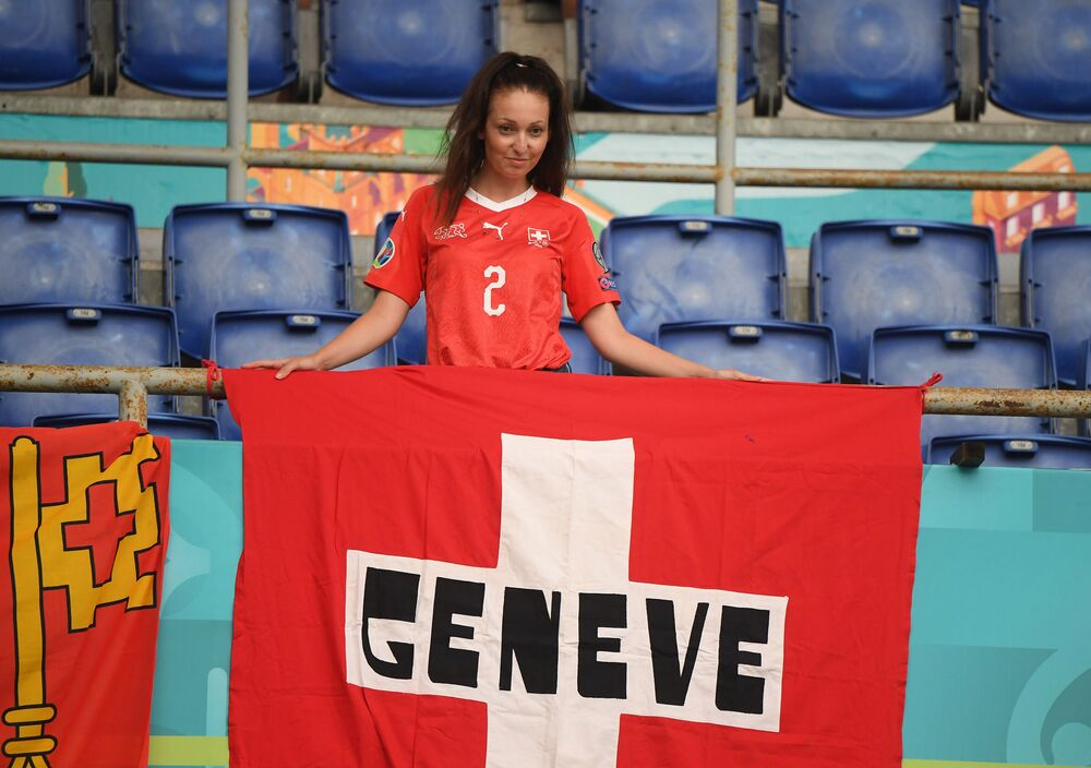 A Swiss fan poses in the stands before the match between Italy and Switzerland at Stadio Olimpico in Rome on 16 June 2021 which Italy won 3-0.