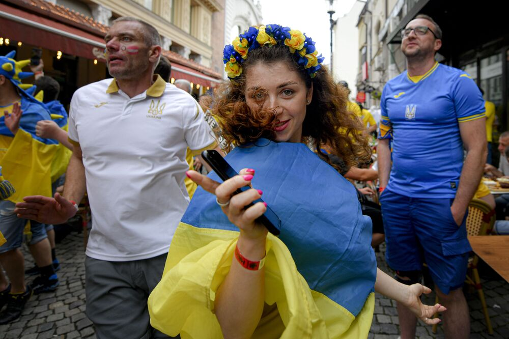 Ukraine fans dance before the Euro 2020 football match between Ukraine and Austria in the old city district of Bucharest, Romania on 21 June 2021. Austria won 1-0.