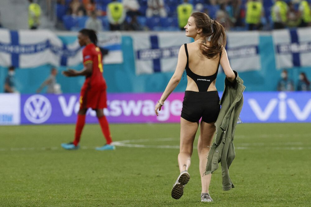 A fan walks onto the pitch during the match between Finland and Belgium at the Krestovsky stadium in Saint Petersburg, Russia on 21 June 2021. Despite, or perhaps because of her presence, Belgium won 2-0.