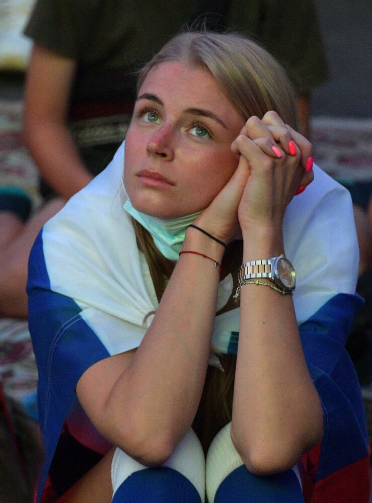 A woman watches a game on a big screen in Saint Petersburg, Russia.