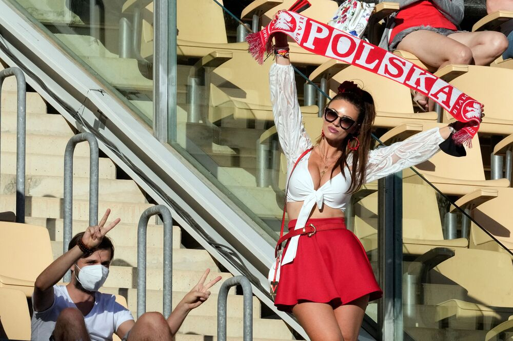 A Poland fan holds up a scarf before the Spain v Poland match at La Cartuja Stadium in Seville, Spain, on 19 June 2021. The game ended in a 1-1 draw.