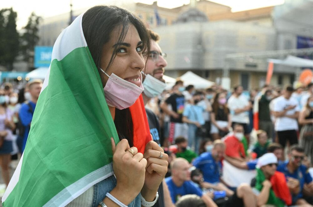 Italy fans cheer their team as they watch on a giant screen, from an official fan zone at Piazza del Popolo in Rome, the match between Italy and Wales at the Stadio Olimpico in Rome on June 20, 2021. Italy wins 1-0.