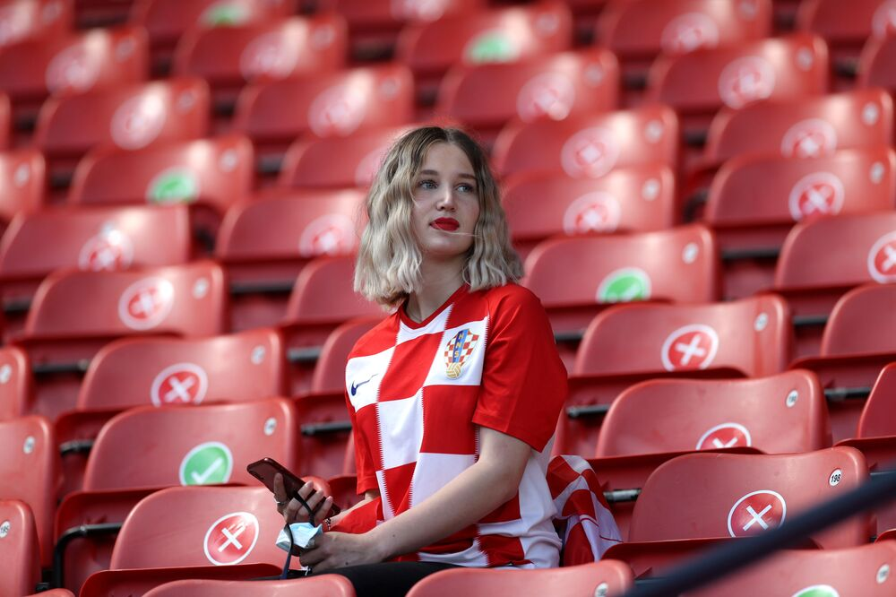 A lone Croatian fan in the stands of Hampden Park in Glasgow, Scotland before the Croatia v Czech Republic match on 18 June 2021 which ended in a 1-1 draw.