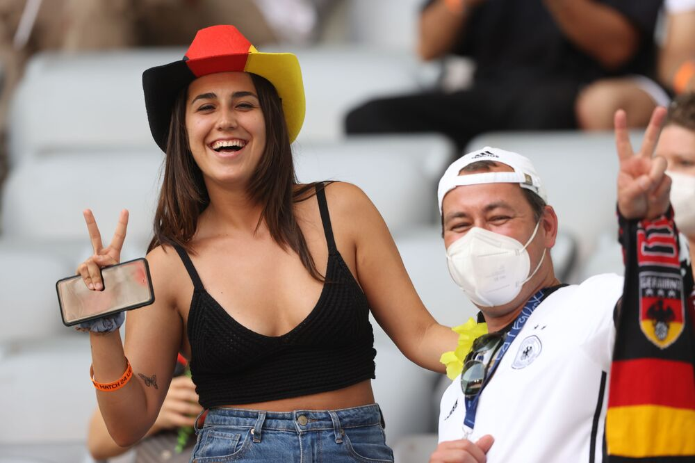 Germany fans pose in the stands of the Allianz Arena in Munich before the Portugal v Germany match on 19 June 2021, which Germany won 4-2.