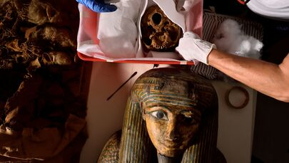 Researchers prepare to move an Egyptian mummy from the Civic Archaeological Museum of Bergamo to Milan's Policlinico hospital to undergo a CT scan in order to investigate its history, in Bergamo, Italy, 21 June 2021.