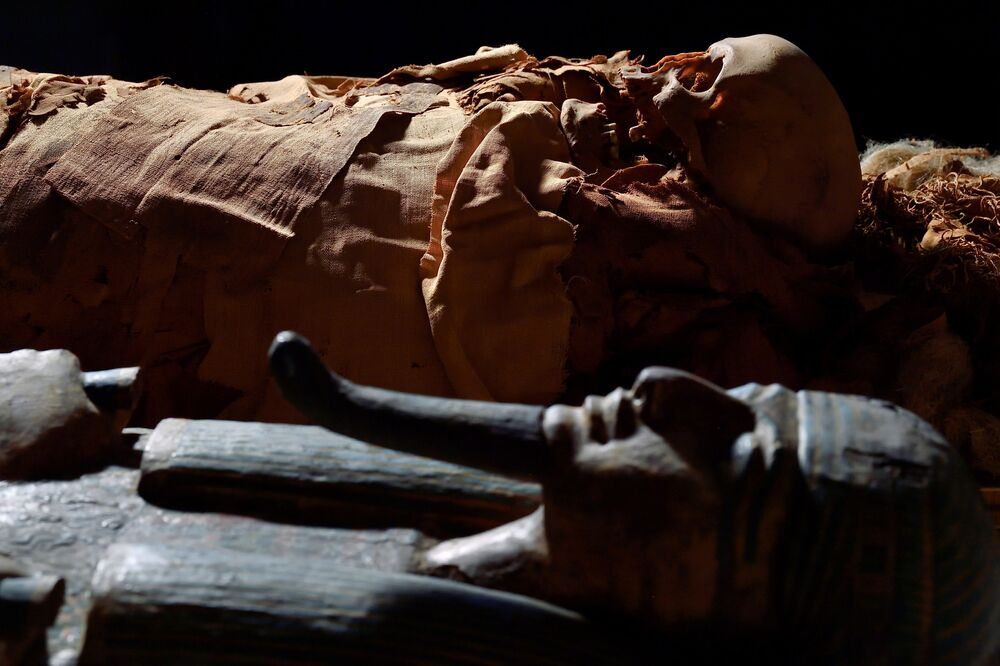 An Egyptian mummy is seen next to its coffin at the Civic Archaeological Museum of Bergamo.