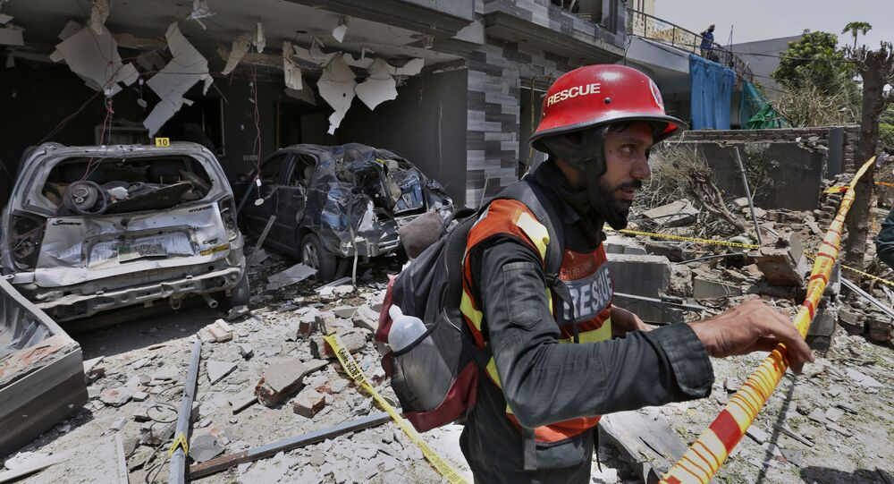 A rescue worker examine the site of explosion in Lahore, Pakistan, Wednesday, June 23, 2021