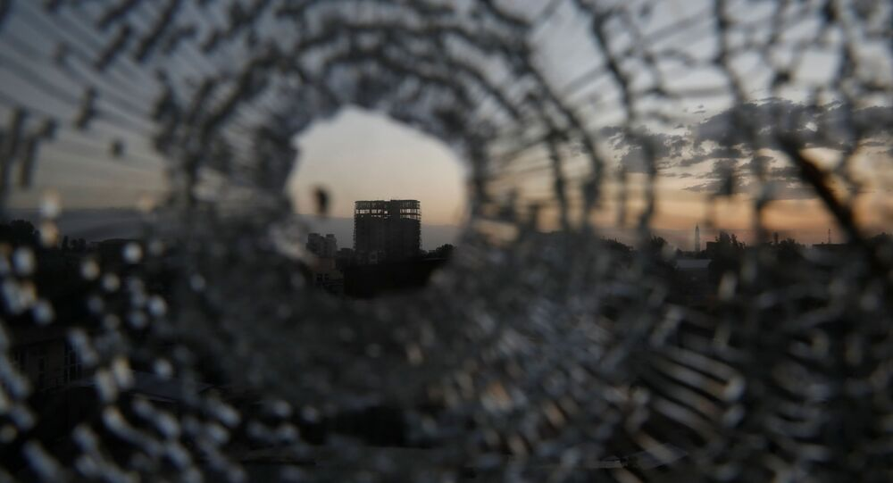 A building is seen through a bullet hole in a window of the Africa Hotel in the town of Shire, Tigray region, Ethiopia, March 16, 2021. Picture taken March 16, 2021
