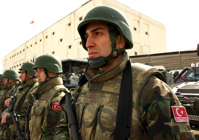 Turkish soldiers in combat gear stand guard outside the headquarters of Camp Anadolu in Kabul, Afghanistan on Thursday, Feb. 11, 2010.
