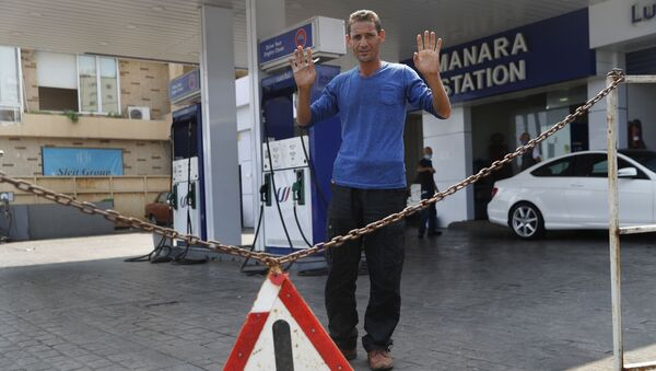 A gas station workers gestures as he saying no fuel at the station, in Beirut, Lebanon, Wednesday, July 29, 2020. - Sputnik International