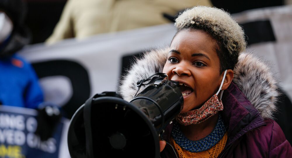 FILE PHOTO: Community activist India Walton speaks through a megaphone as she campaigns to replace four-term Mayor Byron Brown, in Buffalo, New York, U.S., December 15, 2020.