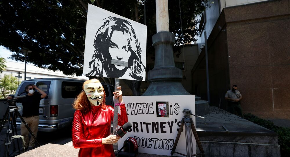 Gabriela Ruiz holding a sign protests in support of pop star Britney Spears on the day of a conservatorship case hearing at Stanley Mosk Courthouse in Los Angeles, California, U.S. June 23, 2021.