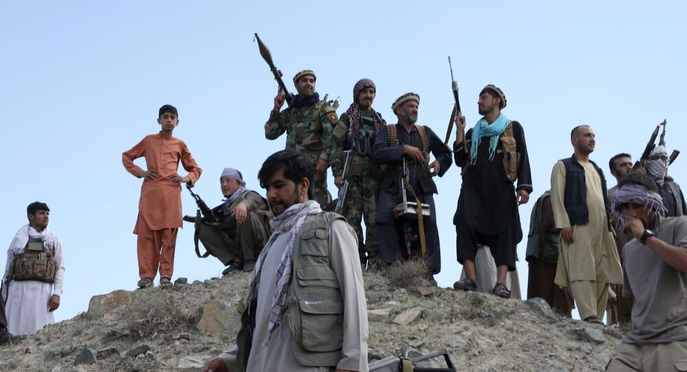 Armed men attend a gathering to announce their support for Afghan security forces and that they are ready to fight against the Taliban, on the outskirts of Kabul, Afghanistan June 23, 2021