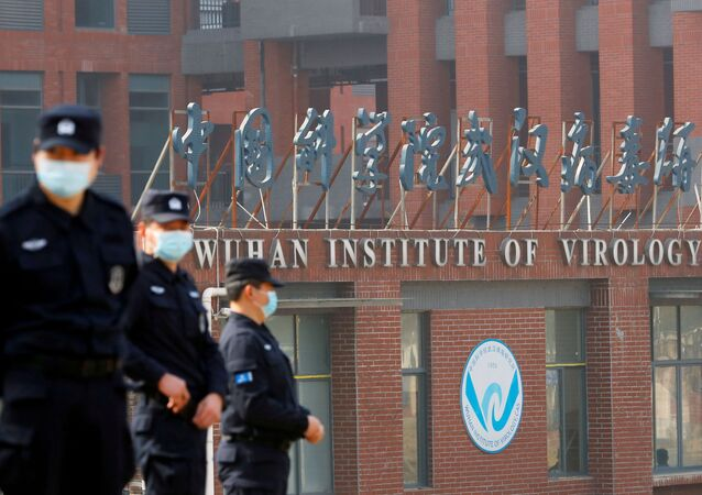 Security personnel keep watch outside the Wuhan Institute of Virology during the visit by the World Health Organization (WHO) team tasked with investigating the origins of the coronavirus disease (COVID-19), inWuhan, Hubei province, China February 3, 2021.