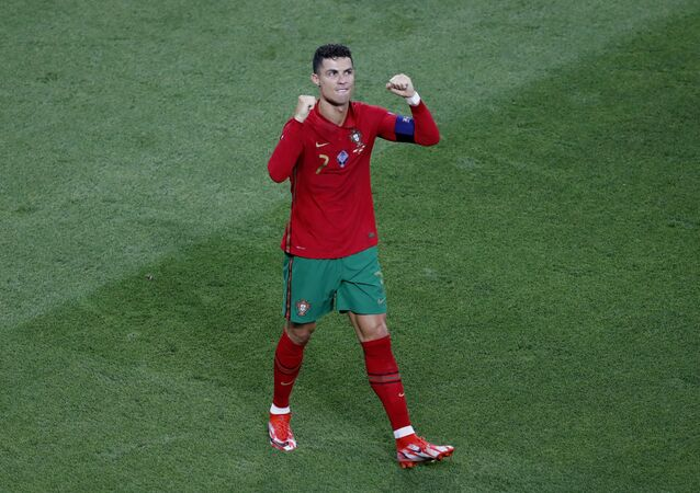 Soccer Football - Euro 2020 - Group F - Portugal v France - Puskas Arena, Budapest, Hungary - June 23, 2021 Portugal's Cristiano Ronaldo celebrates scoring their first goal