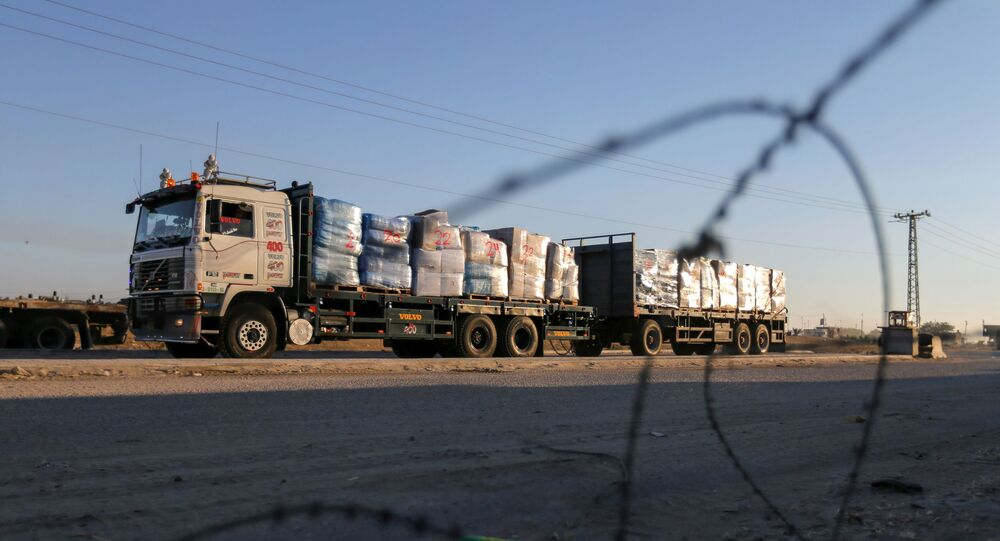A truck carrying clothes for export is seen at Kerem Shalom crossing in Rafah in the southern Gaza Strip, June 21, 2021.