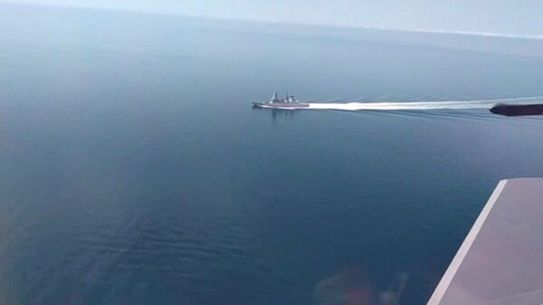 A still image taken from a video released by Russia's Defence Ministry allegedly shows British Royal Navy's Type 45 destroyer HMS Defender filmed from a Russian military aircraft in the Black Sea, June 23, 2021 - Sputnik International