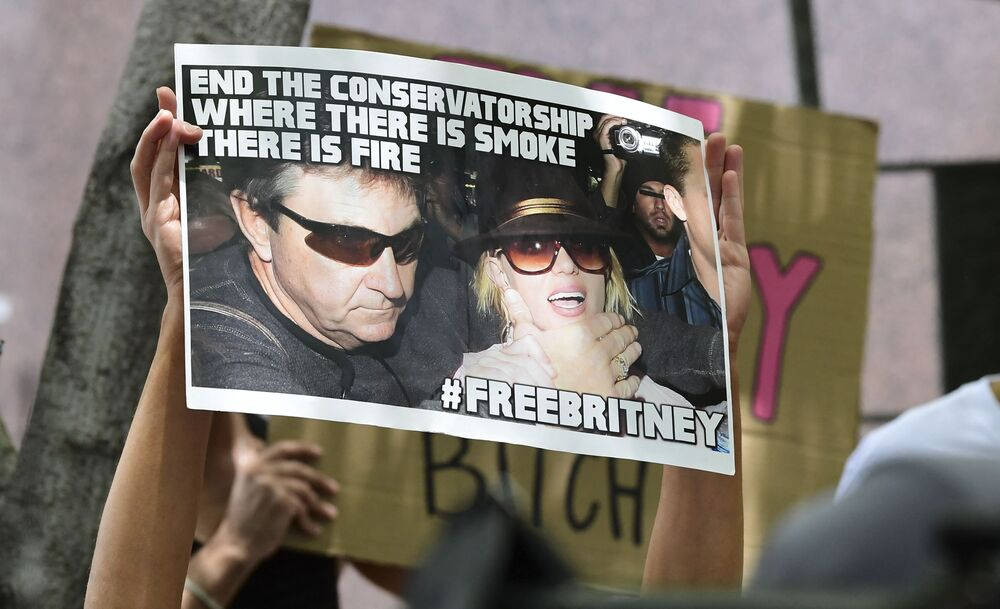 Fans and supporters of Britney Spears hold placards as they gather outside the County Courthouse in Los Angeles.