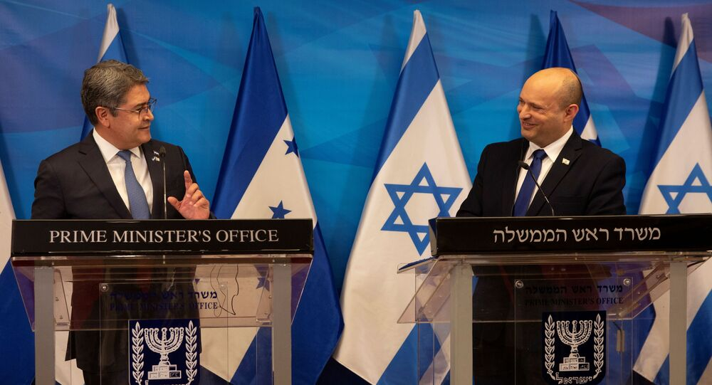 Israeli Prime Minister Naftali Bennett and Honduran President Juan Orlando Hernandez attend a joint statement at the Prime Minister's Office in Jerusalem, June 24, 2021.